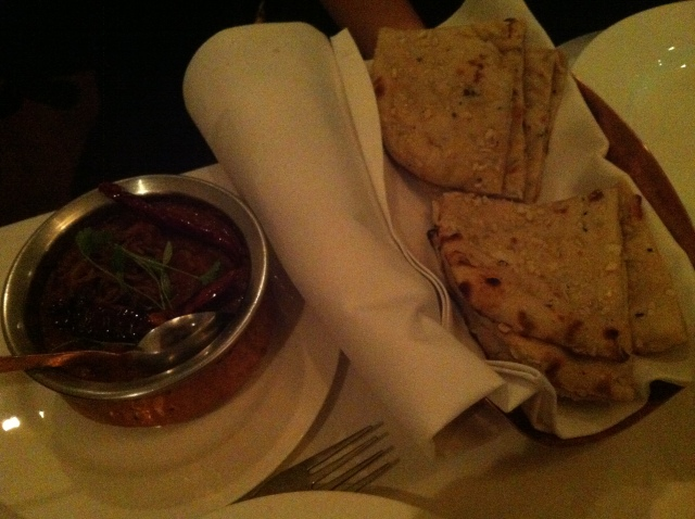 Some sort of curry with garlic naan.