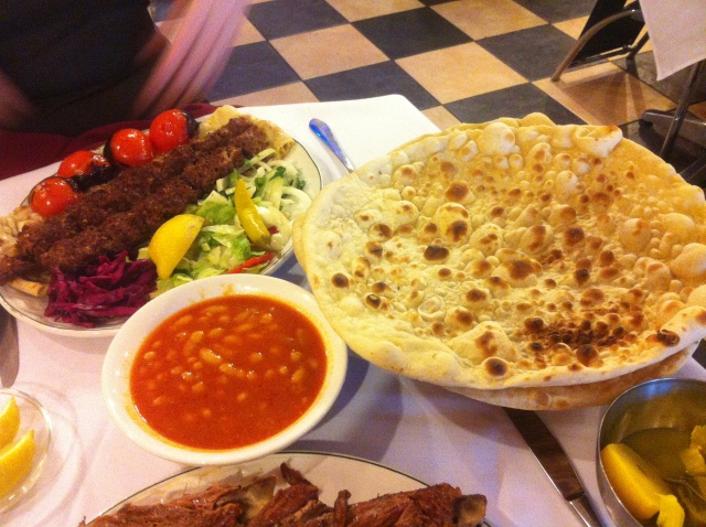 Another textbook example of my hapless handling of my iPhone camera. The object of the photo? The lamb Kuzi peeking up from the bottom of the picture. Also pictured: lamb skewers, white bean sauce and Kurdish naan.