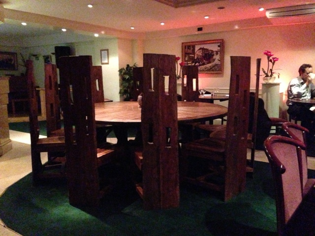 This massive round banqueting table was not laid and presume is set aside for animal sacrifice, other satanic rituals and parties of 8.