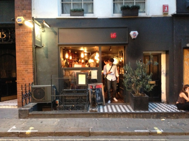 The outside of Pix in Soho. Complete with hipster.