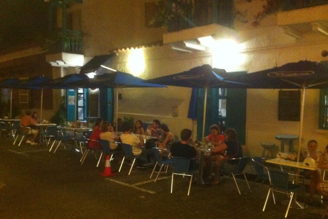 Outside the La Cervicheria. The traffic cone makes the outside tables impervious to oncoming traffic.