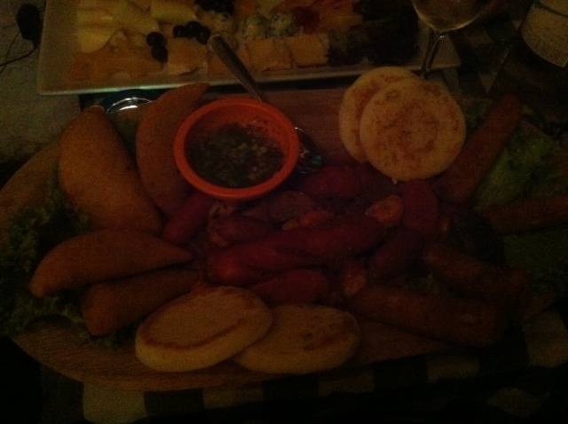 Platter 2. That's a lot of small sausages, empanada, arepas, random meat, yuca ....