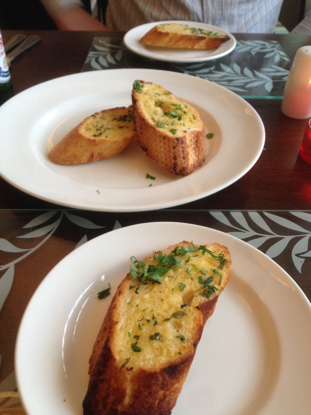 Unnecessarily elongated garlic bread shot.